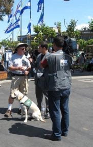 A puppy raiser being interviewed by a TV camera man