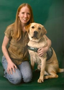 Cristen Phillips with a Guide Dog puppy