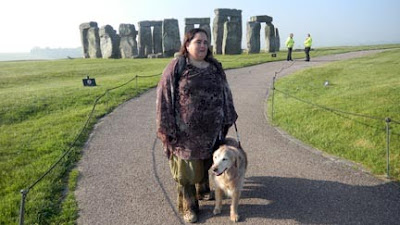Maia Scott with her Golden guide Tessa at Stonehenge