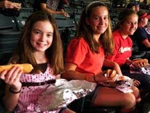 Kathleen Bigley, Jaclyn Bigley and Megan Irving enjoying their hot dogs
