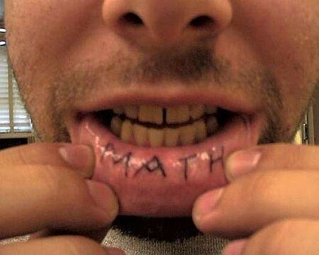 lipstick tattoo. kissing lips tattoo.