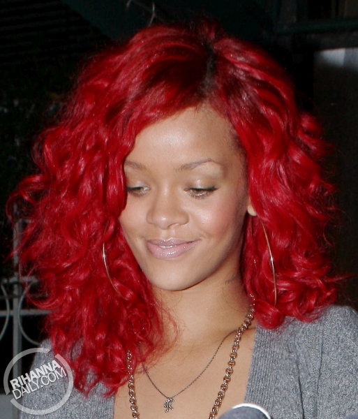 rihanna red hair curly. Rihanna#39;s New Candy Apple Red