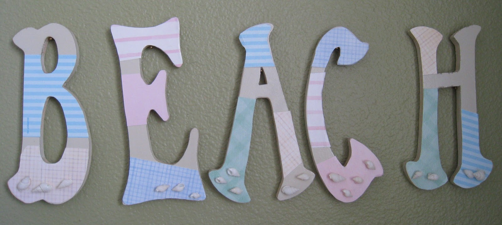 i spray painted them all a beige color then used different colored paper to cover parts of the letters i traced the parts of the letters i wanted to