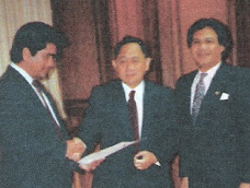 Speaker J. D. Venecia, Handing the Resolution 351 to Cong. Manny Sanchez