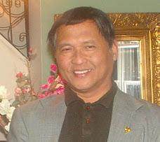 Dr. John E. Ayudtud