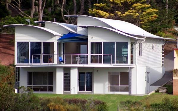 Arquitectura de casas techos curvos ondulados y sensuales for Techos de casas