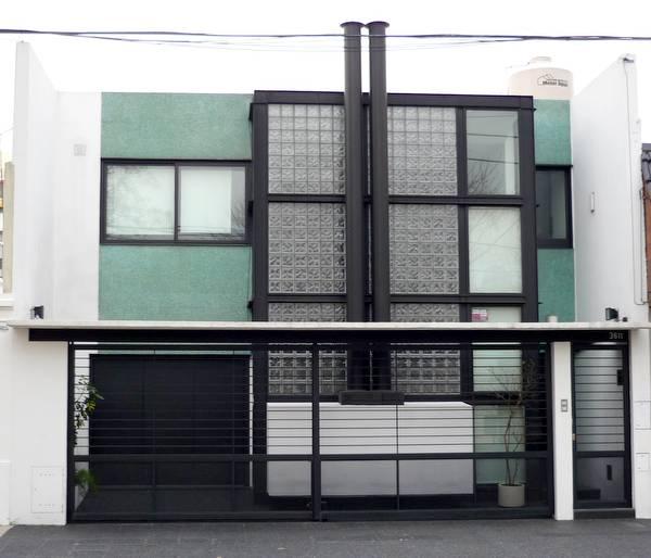 Casa urbana contenporánea entre medianeras