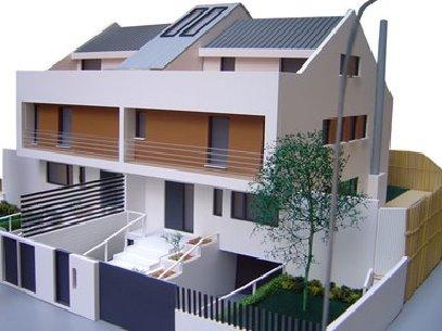 Perspectiva de la maqueta de un proyecto de arquitectura de casas dúplex adosadas