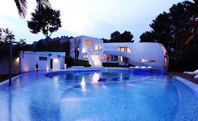 Casa de diseño orgánico contemporáneo vista exterior nocturna
