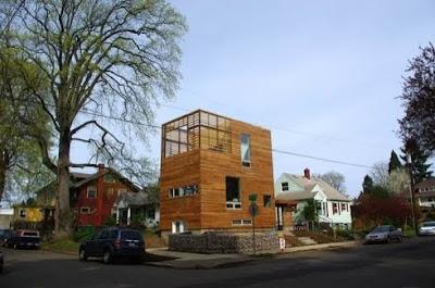 Casa de madera cúbica