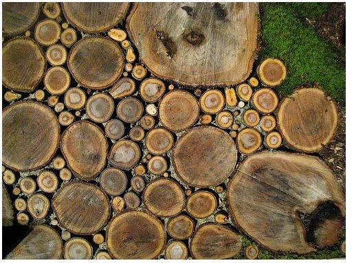 Diseño de vereda para jardín con rollos de troncos
