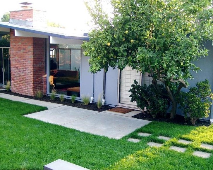 Arquitectura de casas jardines modernos mid century en for Fuentes de jardin modernas