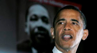 Obama speaks with MLK poster in background