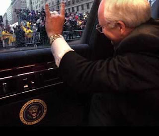 Cheney waves from within an armored limo