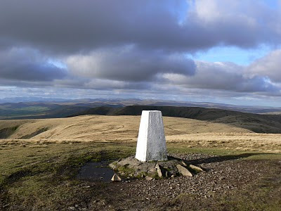 The brilliant white trig point on The Calf in the Howgill Fells