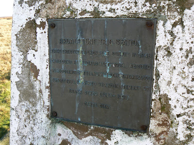 The plaque on the Broadstone Hill trig point following its restoration in 1998 by a local fell runners group in Saddleworth