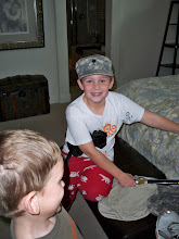 "Christian loves to put on Boyd""s army hat!"