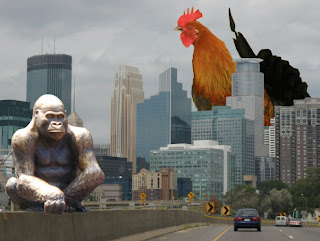 Minneapolis skyline with a giant rooster and gorilla