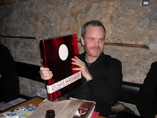 brad mackay poses with doug wright book