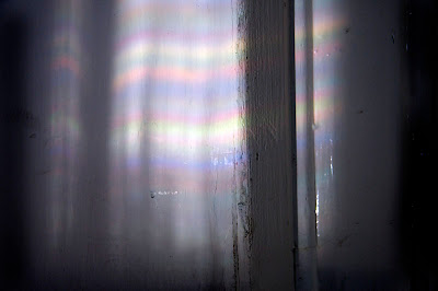coloured light patterns on a white wall