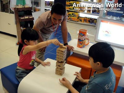 Playing Jenga at Dash of Fun at Eastwood City