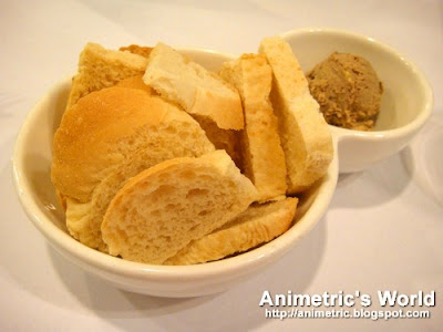 Melba toast with chicken liver pate at Angel's Kitchen