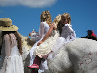 Girls riding horseback in Fourth of July Parade in Makawao, upcountry Maui Hawaii