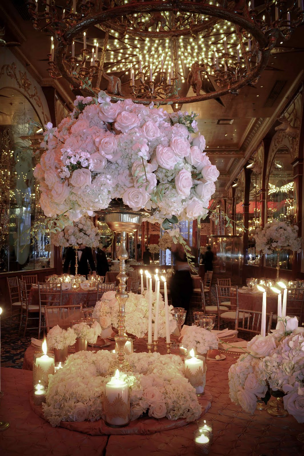 flowers on candelabra centerpiece