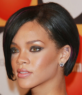 Rihanna Tattoo With Star Tattoo Designs On The Upper Back