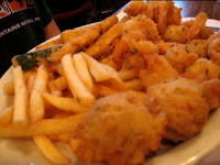 Click to enlarge - Regular order of fried shrimp including French fries, fried zucchini and hush puppies.