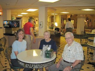 Click to enlarge –  Gilbert, Janis and Effie at The Gathering Place.