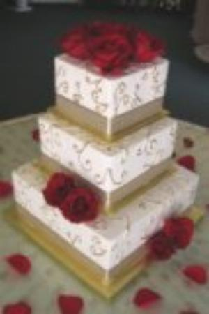 Ivory And Gold Wedding Cake Three tiered square wedding cake with hidden