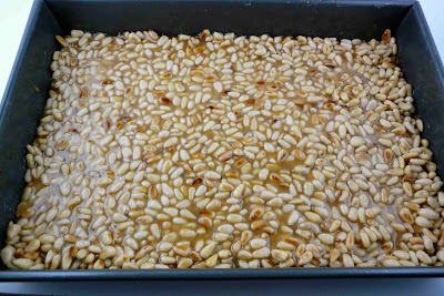 ... sea salt over the top of the pine nuts, gently pressing to adhere