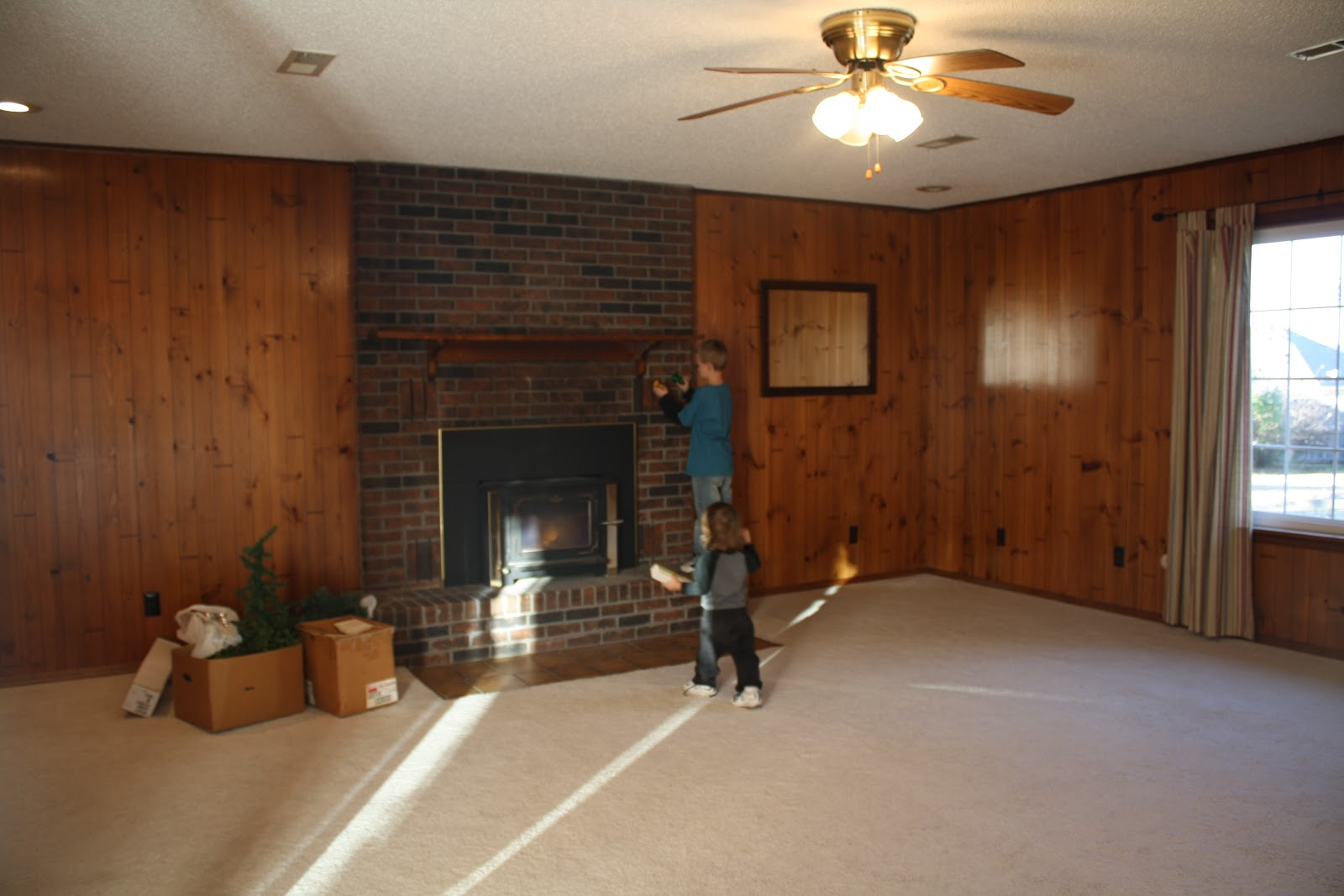 It 39 s good to be queen living room a progress report for Living room ideas with wood paneling