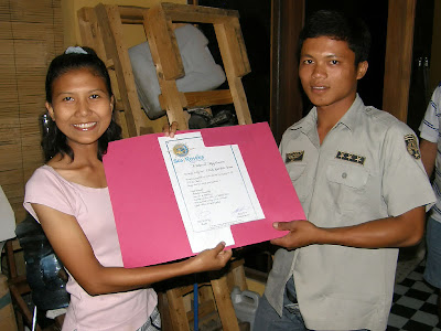 Ditta presents Budi with his certificate