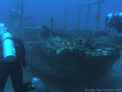 Coral Canyon Wreck with divers, Pemuteran
