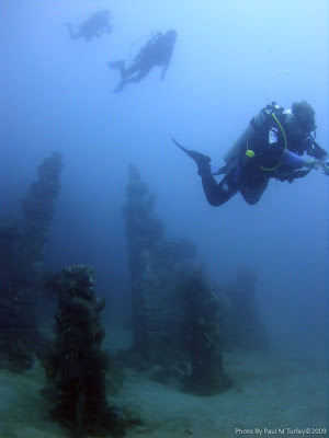 divers descending to the underwater temple gardens of Bali