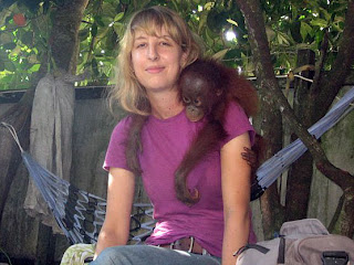 Carolynn and rescued baby orangutan Puyol