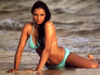 Naina in swimsuit on the beach