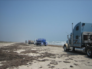 Firm beach road with trucks, Padre Island National Seashore