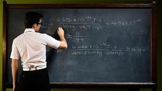 Picture of a mathea]mstician at a blackboard