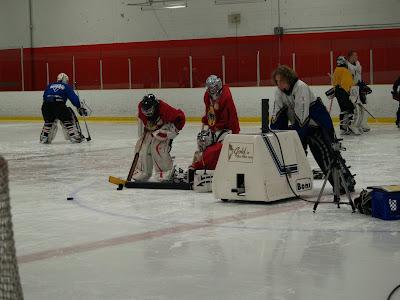 hockey puck shooting machine