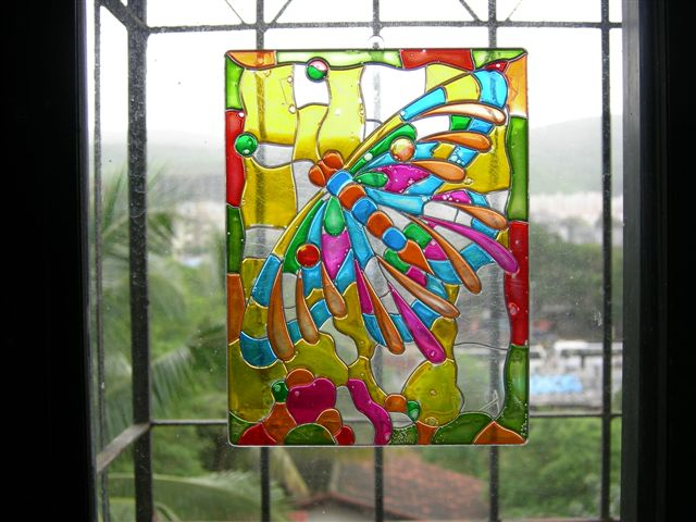 Creating captivating glass painting designs on doors and windows help