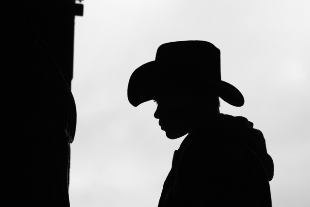 Cowboy Hat Silhouette A camera and a cowboy hat.