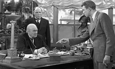 Lionel Barrymore as the banker Henry F. Potter and Jimmy Stewart as the idealistic George Bailey