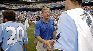 Duke Coach John Danowski, center, praised his players' hard work after the game.