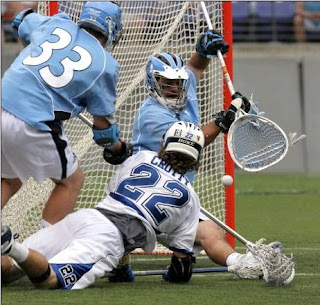 Evans(#33) and Schartzmann stop shot by Duke's Ned Crotty