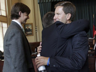 Dave Evans hugs father as Collin Finnerty smiles after bar hearing