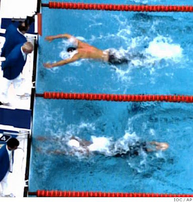 Phelps over Cavic by 1/100 photo, top view
