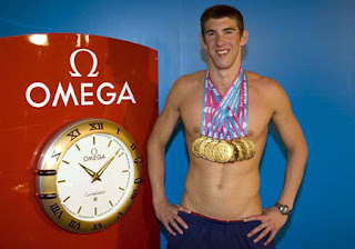 Michael Phelps wins by 1/100 of a second over Cavic of Serbia